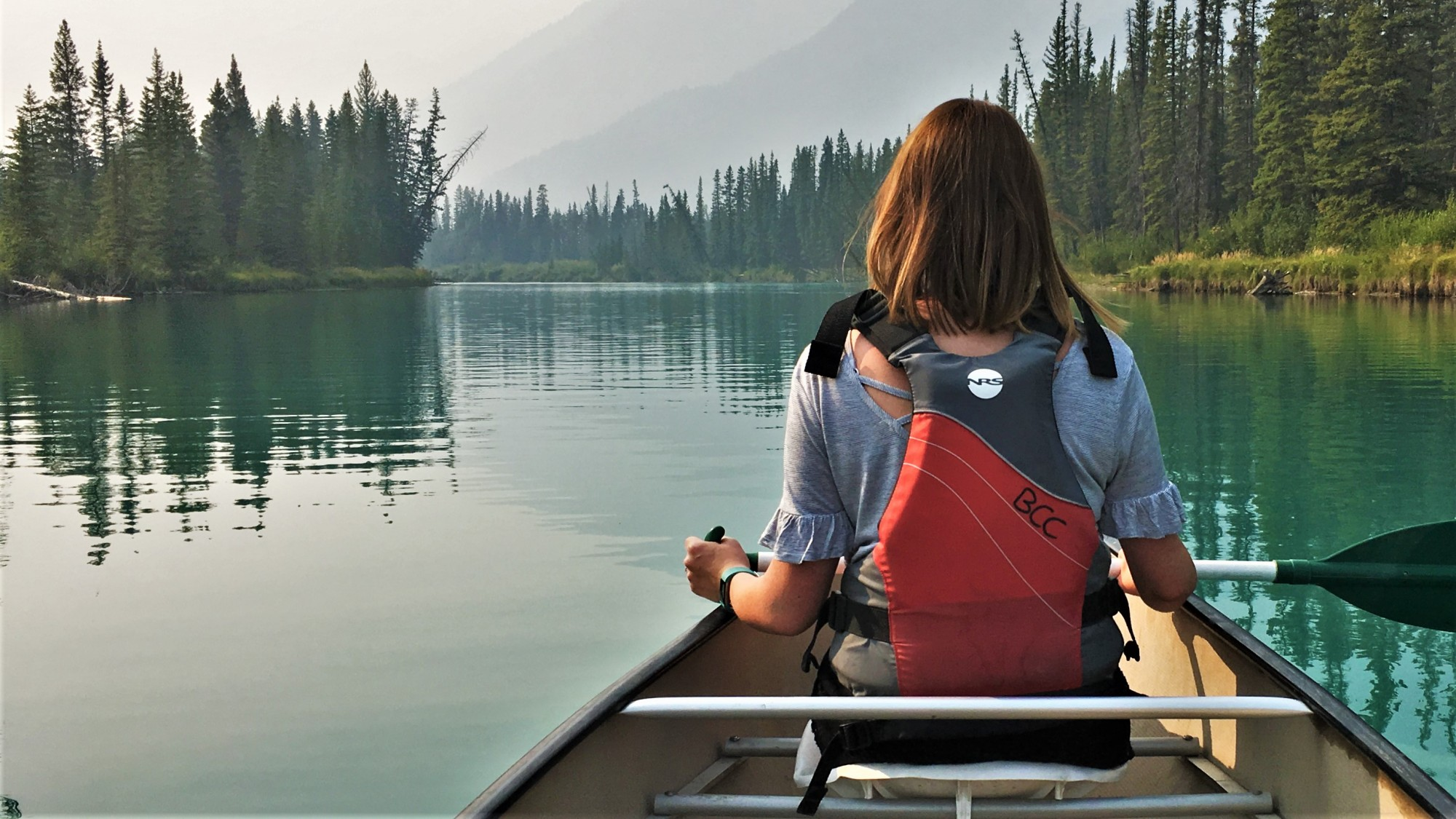 Sarah canoeing the Bow River in Banff