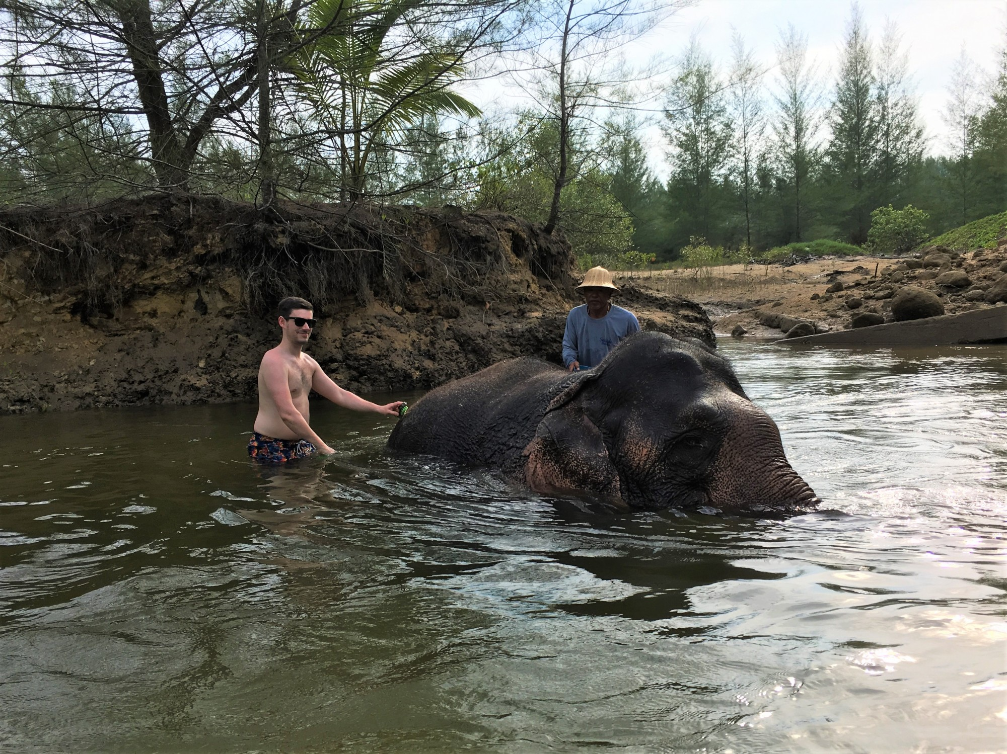 The Seaside Retreat Washing the Elephants in the river, Khao Lak, Thailand